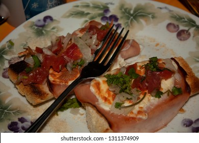 Traditional owls in a Mexican food, ham on rolls or baguette with cheese, onion and cilantro tomatoes
