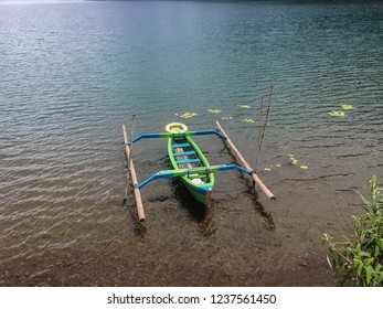 Traditional Paddle Canoe Parked At The Edge Of The Lake Beratan At Bedugul, Tabanan, Bali, Indonesia