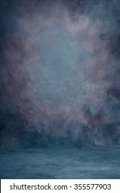 Traditional painted canvas or muslin fabric cloth studio backdrop or background, suitable for use with portraits, products and concepts. Dramatic, stormy dark purples and blues.