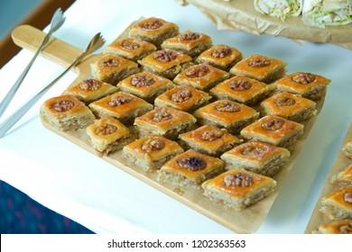 Traditional pakhlava baklava pastry on novruz tray with dry fruits snack. Azerbaijan national Novruz eastern new year spring celebration concept
