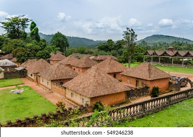 Traditional palace of the Fon of Bafut with brick and tile buildings and jungle environment, Cameroon, Africa
