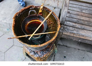 Traditional pan and stove consist of liquid wax using for making hand writing batik art