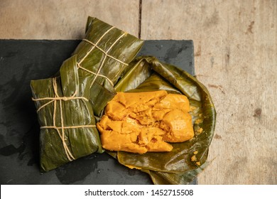 Traditional Panamanian tamales, on a wooden table
