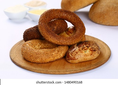 Traditional pastries Turkish bagels simit with sesame on wooden board