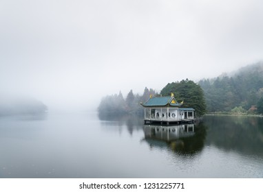 traditional pavilion on lake, beautiful lushan landscape of clouds and fog