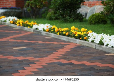Traditional paving clinker pattern in front of the house. Beautiful garden design. Illustration for construction company cards.
