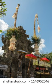 Traditional penners and umbrellas decorate the roadside during the festival of Galungan in Bali, Indonesia.