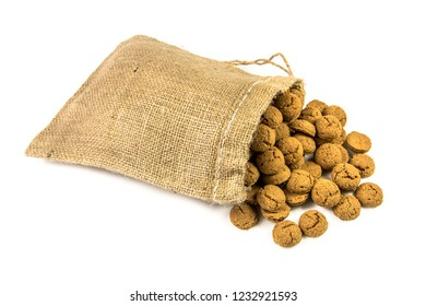 Traditional pepernoten treats in jute bag on white background for annual Sinterklaas holiday event in the Netherlands on december 5th