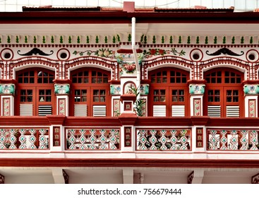 Traditional Peranakan or Straits Chinese vintage Singapore shop house with colourful ornate facade in historic Little India