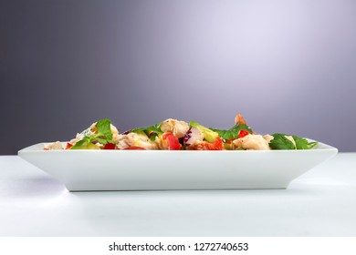 Traditional peruvian ceviche seafood with vegetables and lime