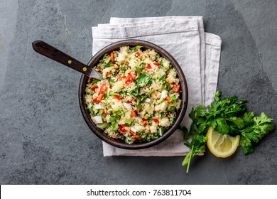 Traditional peruvian quinoa quinua salad in clay bowl, slate gray background.