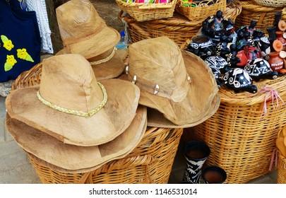 Traditional peruvian souvenirs - hats and ceramic - in Mancora handicraft market, Peru.