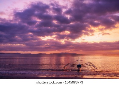 Traditional philippine boat in Corong-Corong beach in El Nido at sunset lights. Palawan island, Philippines