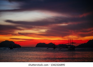 Traditional philippine boats in Corong-Corong beach in El Nido at sunset lights. Palawan island, Philippines