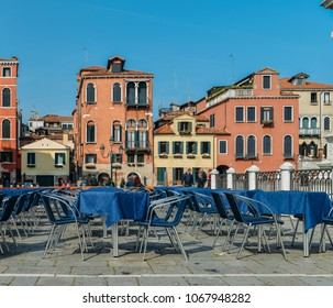 Traditional piazza with tables on terrace in Venice, Veneto, Italy.