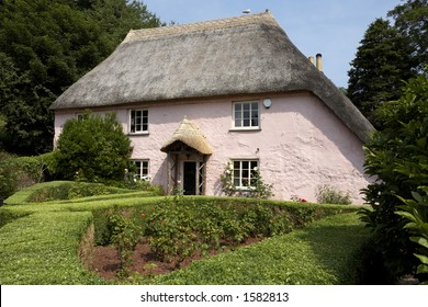 traditional pink painted english cottage in the small village of cockington