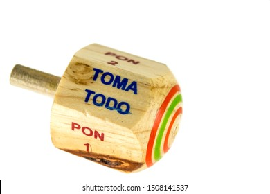 """Traditional pirinola mexican handmade wooden toy with titles in spanish """"take all, put one, put two, everyone puts"""""""