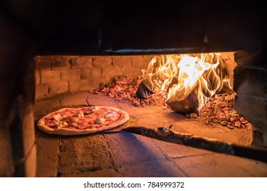 Traditional pizza oven with firewood