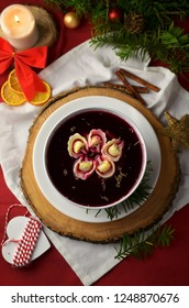 Traditional Polish chirstmas borscht with dumplings on christmas eve table