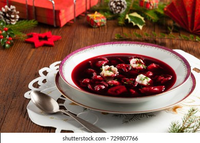 Traditional, Polish Christmas red borsch with dumplings. Front view.