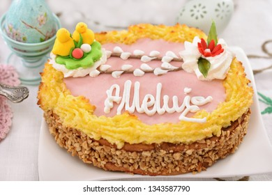 traditional polish easter butterscotch cake called mazurek with decoration on festive table