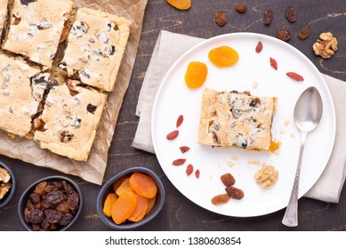 Traditional Polish Easter cake called Mazurek with plenty of dried fruits and nuts, top view