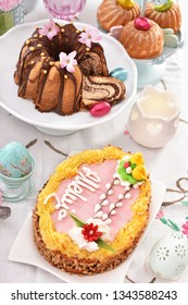 traditional polish easter pastries-ring cake,mini ring cakes and butterscotch cake called mazurek with decoration on festive table