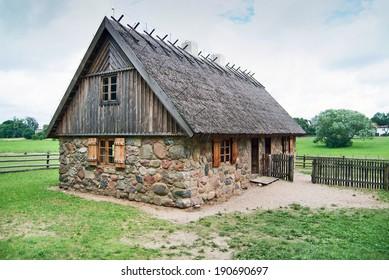 Traditional polish house on a farmyard.
