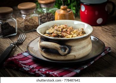 Traditional polish sauerkraut (bigos) with mushrooms and meat. Shallow depth of field.
