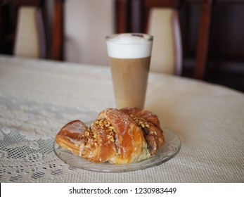 Traditional polish st. Martins croissants in Poznan and coffee Latte. Cafe Latte in glass and pastry with poppy seeds and nuts