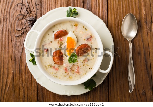 Traditional Polish white borsch with Easter decoration. Top view