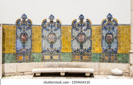 Traditional polychromatic decorative tiles with birds on the central medallion on both sides of the Chafariz da Cordoaria in Lisbon, Portugal
