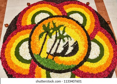 Traditional Pookalam, intricate colourful arrangement of flowers on floor. Flower bed decoration, seamless floral pattern of tropical fresh blooms on Onam, Vishu festival celebration Kerala, India.