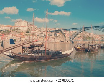 traditional port wine boats and Douro river embanment, Portugal, retro toned