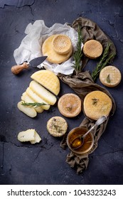 Traditional Portugese semi-soft cheeses from evora alentejo region served with fresh rosemary and honey. Top View. Copy Space
