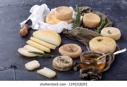 Traditional Portugese semi-soft cheeses from evora alentejo region served with fresh rosemary and honey.