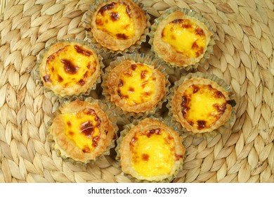 Traditional portugeuse  home made egg tarts - pastries pasteis de nata in tin molds