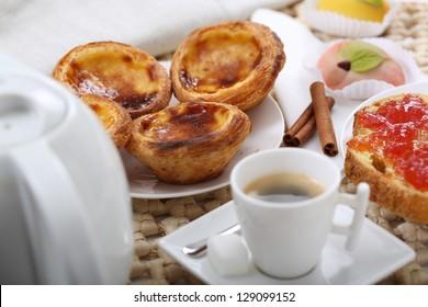 """traditional portuguese cakes - cream cake """"pasteis de nata"""" - shallow DOF - focus inside first cream cake"""