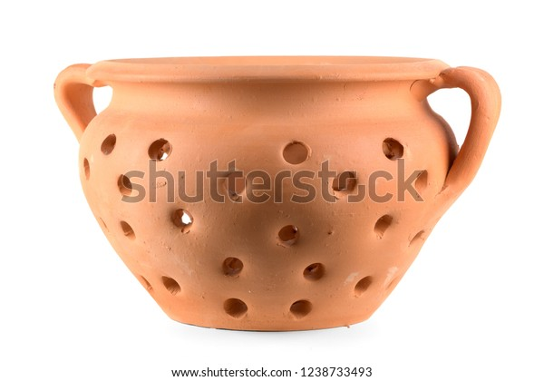 Traditional portuguese ceramic pot with holes for baking chestnuts isolated on white background