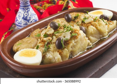 Traditional Portuguese Codfish baked with olive oil and Potatoes. Cooked Cod