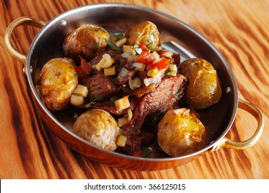traditional Portuguese dish with roasted beef and potatoes