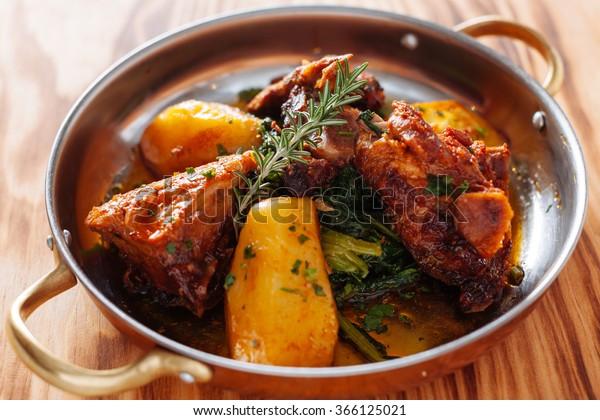 traditional Portuguese dish roasted lamb and potatoes