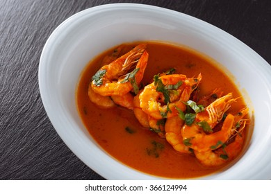 traditional Portuguese dish with shrimp on black background