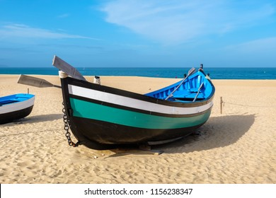 Traditional portuguese fishing boat on the beach. Nazare, Portugal