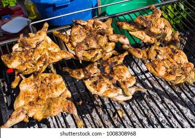 Traditional portuguese piri piri chicken on the BBQ, Madeira island
