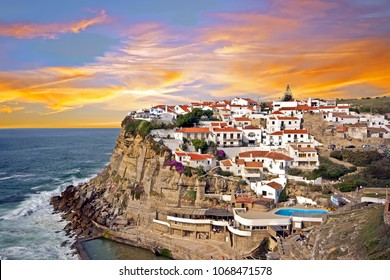 Traditional portuguese village on a cliff overlooking the ocean in Azenhas De Mar, Portugal at sunset