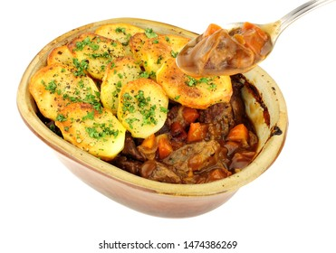 Traditional potato topped Lancashire hotpot isolated on a white background