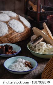 traditional putu mayam Idiyappam string hoppers with brown sugar grated coconut chickpea curry is a popular cuisine of Kerala and malaysia. Rice flour pressed into white noodle form and then steamed