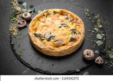 Traditional quiche pie with mushrooms, chicken and cheese.