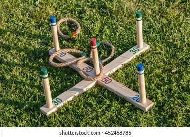Traditional quoits set.  Wooden frame with rope hoops.  Quoits is an ancient sport, One rope is over the 50 point peg.